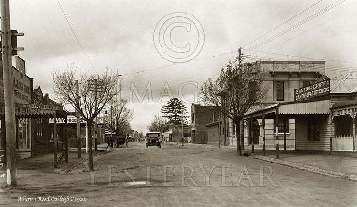 Atherton Road, Oakleigh, Melbourne. On the left is a fish shop and the Oakleigh Times Printing Office. Moran & Cato grocers are further back on the left. On the right is Easton & Griff (Bakers & Pastrycooks) and the National Bank of Australasia. C.1920s
