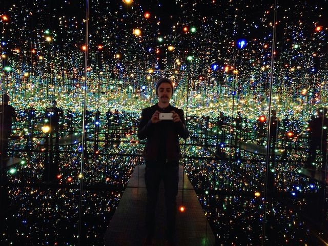 """Artist Yayoi Kusama's new exhibition is titled """"I Who Have Arrived in Heaven"""" just opened at the West 19th Street spot, where you'll find 27 new large-scale paintings, a video installation, and 2 infinity rooms. 'Infinity Mirrored Room—The Souls of Millions of Light Years Away' is a cube lined with mirrored panels and a reflecting-pool floor that rebound multicoloured light from suspended LEDs."""
