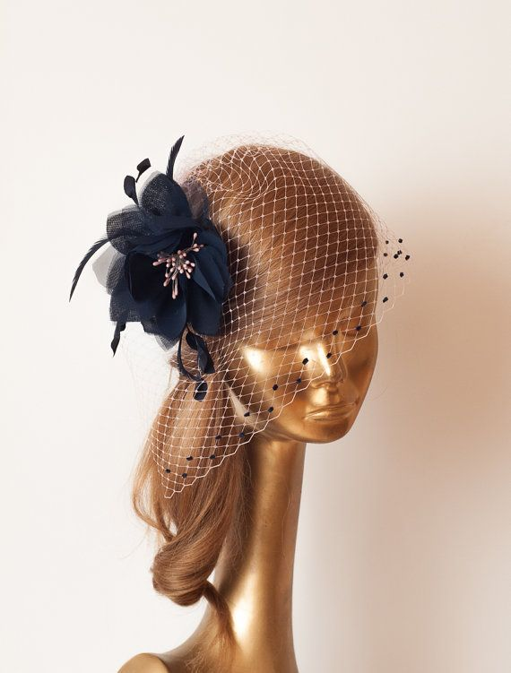 Unique Silk Dark Navy Blue Flower with Pale Pink Birdcage Veil with navy dots. Decorated with Fine Quality Feathers. It is very comfortable and easy to wear, Can be mounted on clip or comb (please add your option to comments of your order) This will be made with skill and care,by me in Poland. If you need any info please contact me :)  --------------------------- SHIPPING INFORMATION  I will ship your purchased item within 2-4 business days after receiving payment to your etsy address…