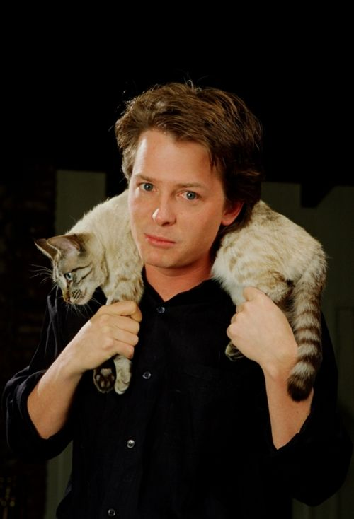 No, Michael, that cat is not a scarf.  And if it scares you put it down.