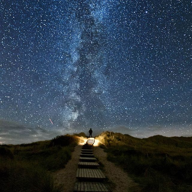Sylt, Germany.  The following website gives the photographer's explanation of how the photo came about:  http://500px.com/ThomasZ/stories/53311/the-making-of-my-god-it-s-full-of-stars