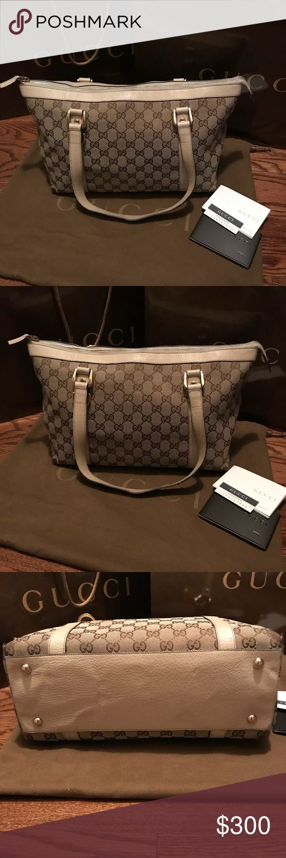 """Gucci Canvas Tote Authentic Gucci gg monogram canvas tote in ebony/tan color, cream leather trim with gold-tone hardware, double shoulder strap; perfect size everyday bag (approximately 15""""x9""""x5""""); protective feet at base, zip closure at top, interior has one zip pocket and one cellphone pocket; In great condition except minor scuff at the four bottom corners (see the last pic); comes with dust bag, original Gucci box and shopping bag Gucci Bags Totes"""