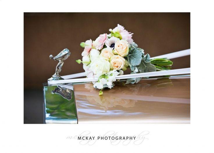 Wedding bouquet on antique car bonnet