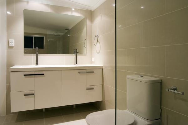 beige tiles white vanity