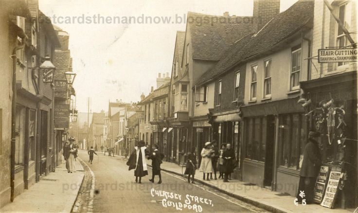 Chertsey Street c.1910.  The Dolphin on the left.  The Leopard and Spread Eagle further away on the right.