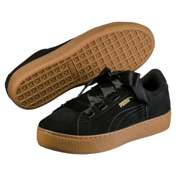 The PUMA Vikky Platform Ribbon is a basketball inspired womens platform sneaker featuring a feminine bow lacing. The platform tooling is put together with a classic suede upper and debossed formstripe for a classic look. The shoe also features the SoftFoam comfort insert for a comfy walk and to keep your feet fresh. A trendy and feminine shoe for the street!
