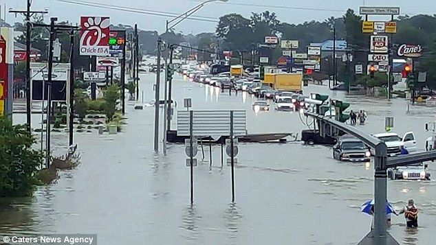 The Ochsner Medical Center in Baton Rouge has evacuated about 40 patients and is expected to evacuate another 10-15 (pictured, cars backed up on a flooded road)
