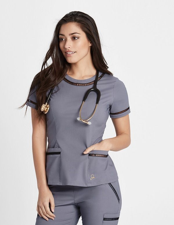 The Ladder Lace Top in Graphite is a contemporary addition to women's medical scrub outfits. ShopJaanuufor scrubs, lab coats and other medical apparel.
