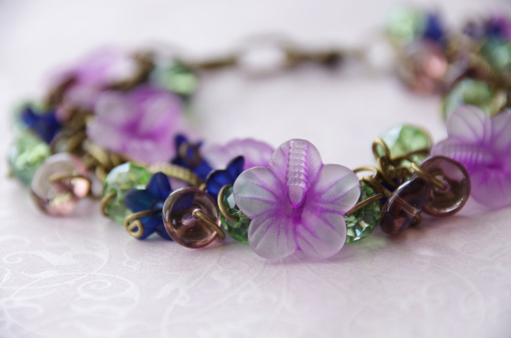 Flower Charm Bracelet: Handmade Flower and Swarovski Crystal Brass Charm Bracelet. $29.95, via Etsy.