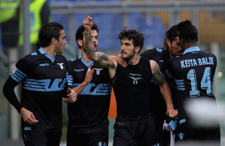 Danilo Cataldi Photos Photos - Danilo Cataldi (C) with his teammates of SS Lazio celebrates after scoring the team's second goal during the Serie A match between SS Lazio and AC Chievo Verona at Stadio Olimpico on January 24, 2016 in Rome, Italy. - SS Lazio v AC Chievo Verona - Serie A