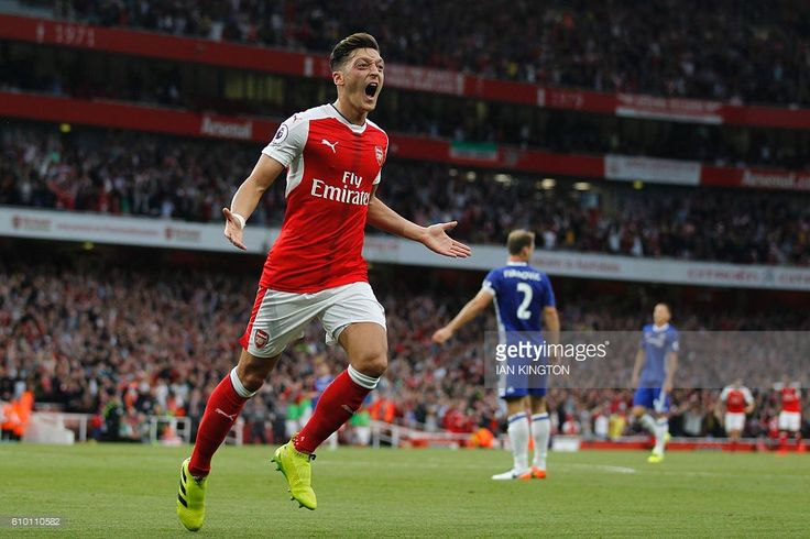 Arsenal's German midfielder Mesut Ozil celebrates scoring their third goal during the English Premier League football match between Arsenal and Chelsea at The Emirates stadium in London, on September 24, 2016. / AFP / IKIMAGES / Ian Kington / RESTRICTED TO EDITORIAL USE. No use with unauthorized audio, video, data, fixture lists, club/league logos or 'live' services. Online in-match use limited to 45 images, no video emulation. No use in betting, games or single club/league/player…