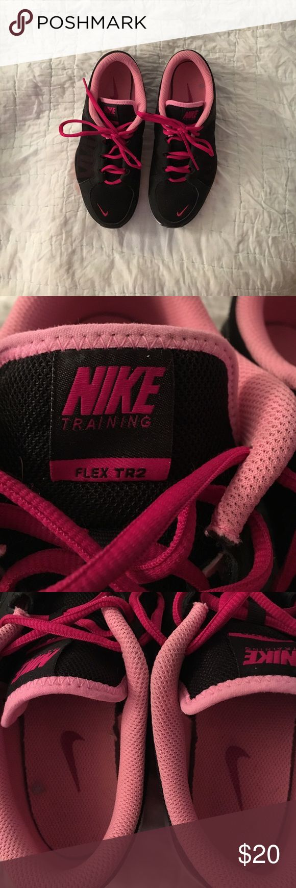 Women's Nike Training Women's 8 1/2 Nike Training Flex TR2. Black, pink, hot pink. Rarely worn. Paint spot in left shoe. See pics. Lots of life left in them. Please see all pics and feel free to make a reasonable offer. No holds. No trades. Nike Shoes Athletic Shoes