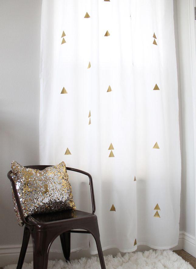 Metallic twist - add gold vinyl iron-on shapes / 15 IKEA Hacks to Dress Up Your Windows via Brit + Co.
