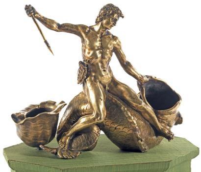 JEUNE GARÇON CHEVAUCHANT UN DAUPHIN AUX ARMES DES BOURBON-CONDÉ Par Taddeo LANDINI (Florence, vers 1561 - Rome, 1596) Rome, vers 1590 MATÉRIAU Bronze doré et patiné Marque aux armes des Princes de Condé H. 19 cm (27,5 cm avec socle), L. 25 cm, P. 13 cm