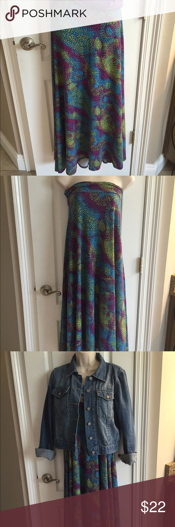 Lularoe Maxi Skirt Size M Beautiful colors of blue, purple & yellow. This Lularoe Maxi can be worn as a skirt or dress. New without tags. LuLaRoe Skirts Maxi