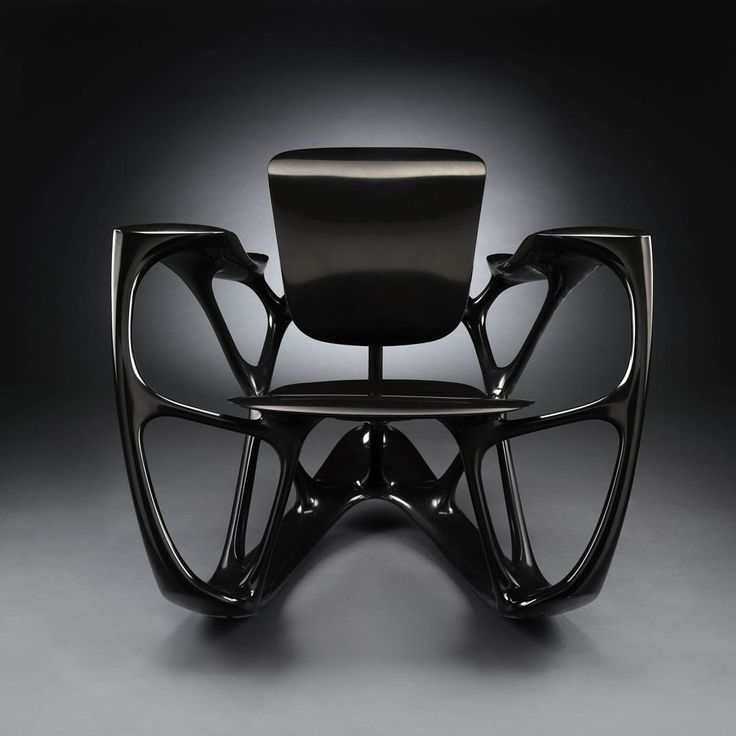 Joris Laarman. This bone rocker is made of black marble resin following an algorithm originally developed for the auto industry.