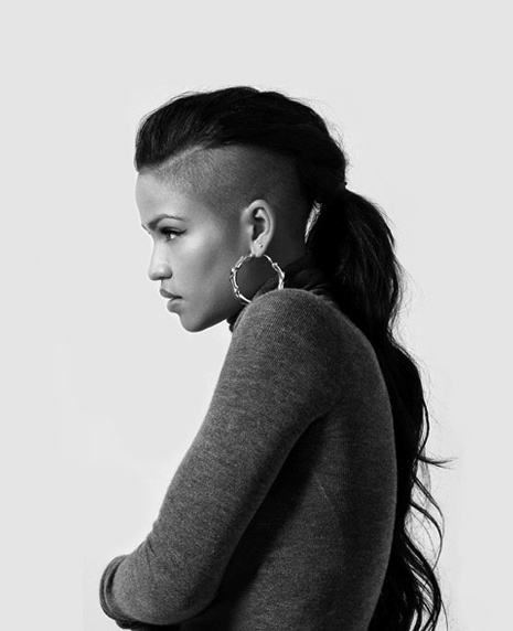 Undercut with no bangs in ponytail.
