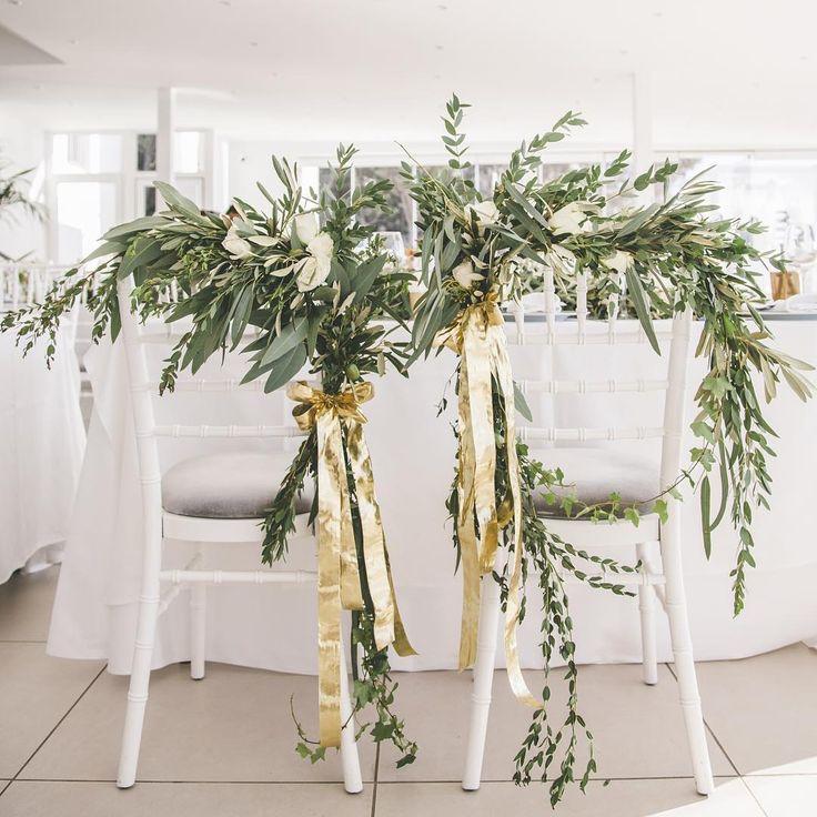 His & Hers chairs should always stand out!  #weddingreception #weddingdecor #flowerdesign #santoriniwedding