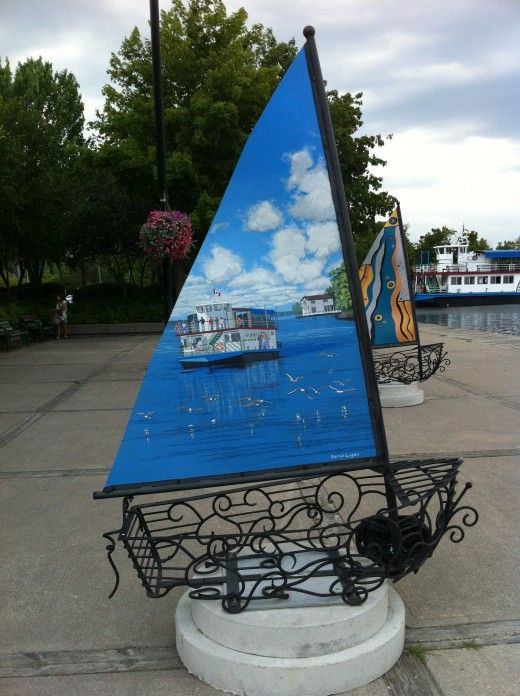 Streets Alive Sailboats Street-Art in Orillia Ontario In 2011 the theme for Streets Alive was 60 Sails Orillia Island Princess painted on this sail.