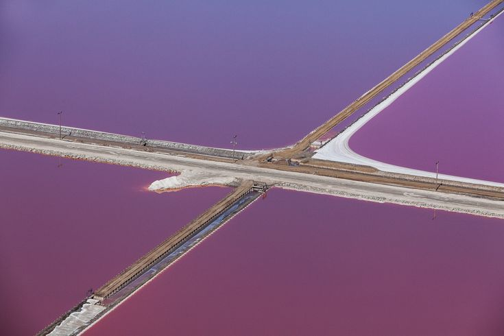 Artist Julieanne Kost shot these beautifully vibrant aerial photographs of purple-hued salt flats in the San Francisco Bay. The photos are part of her ongoing book project, Window Seat: The Art of ...