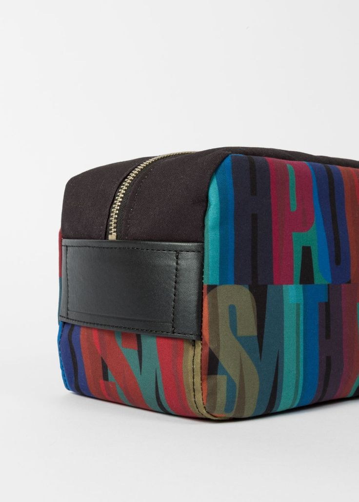 Men's 'Paul Smith' print wash bag with an indigo waterproof interior lining, a zip fastening compartment and signature stripe trims on the side.