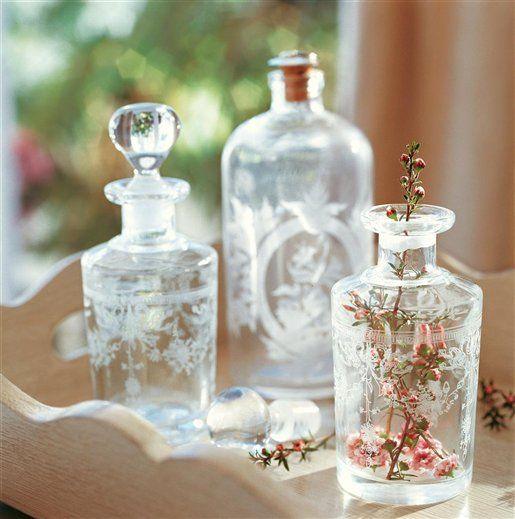 etched botanical motif bottles for flowers or branches