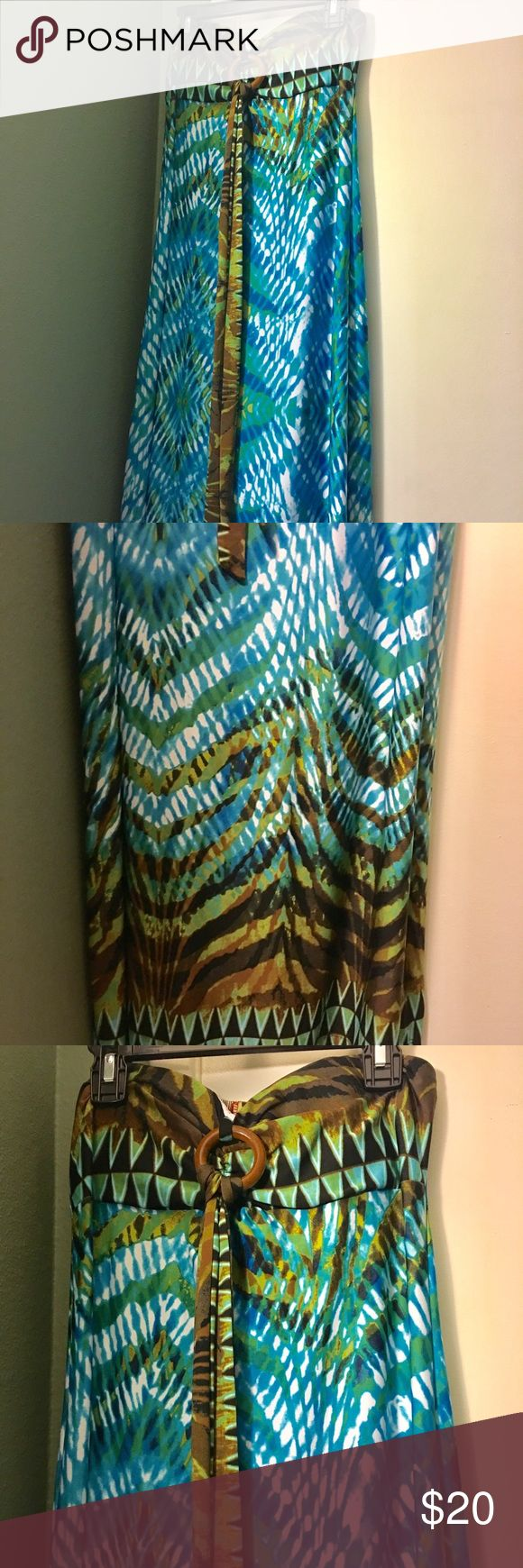 NWOT XS Long Blue Green Maxi Dress by HeartSoul NWOT XS Long Blue Green Brown Maxi Halter Dress by HeartSoul. Can hem the bottom if too long. Soft thin material. Never worn. Padded bra area. Has wooded circle with tie to tie at back of neck area. HeartSoul Dresses Maxi