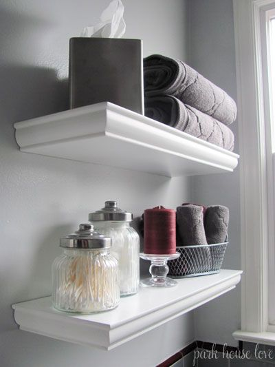 floating shelves over toilet tissue box containers baske would be great in spare bathroom