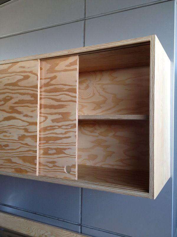 Sliding cabinet doors and discreet handles keep the piece looking sleek.