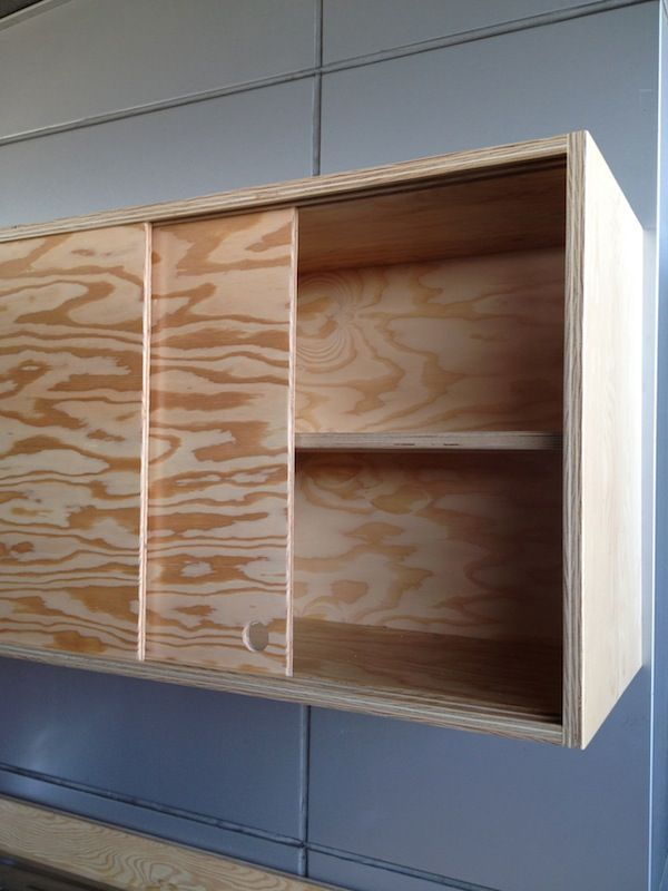 sliding cabinet doors and discreet handles keep the piece On sliding cupboard doors