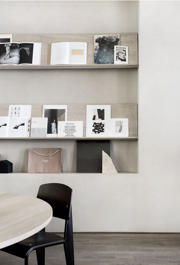 Recessed office studio storage and book display | Office design can be this. Kinfolk shows how to do paired down and welcoming at their wonderful Copenhagen residence. Photo: Jonas Bjerre-Poulsen