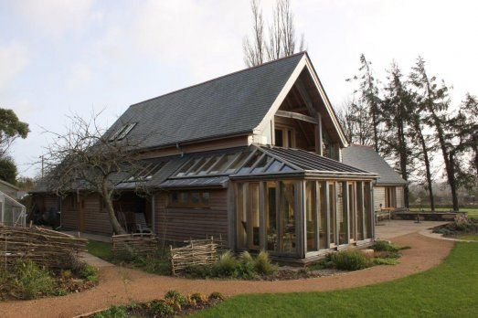 Barn house with wraparound conservatory and recessed balcony