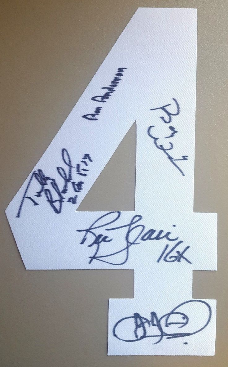 Number 4 signed by the Four Horsemen (Arn Anderson, Ric Flair, Tully, JJ Dillion, and Barry Windham)