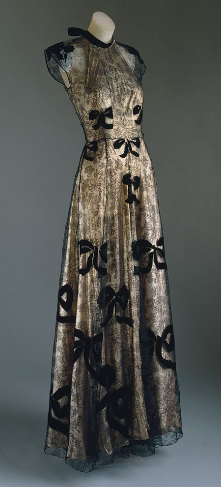 Evening gown, 1939 Pale pink lamé and black silk lace appliquéd with black silk velvet / The Metropolitan Museum of Art