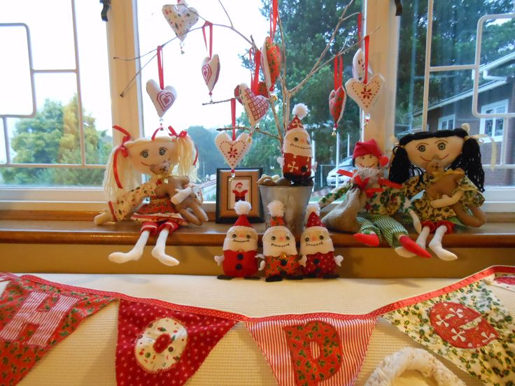Christmas bunting, rag dolls in Christmas attire, little Santa with choc in pocket, cross-stitch hearts and picture.