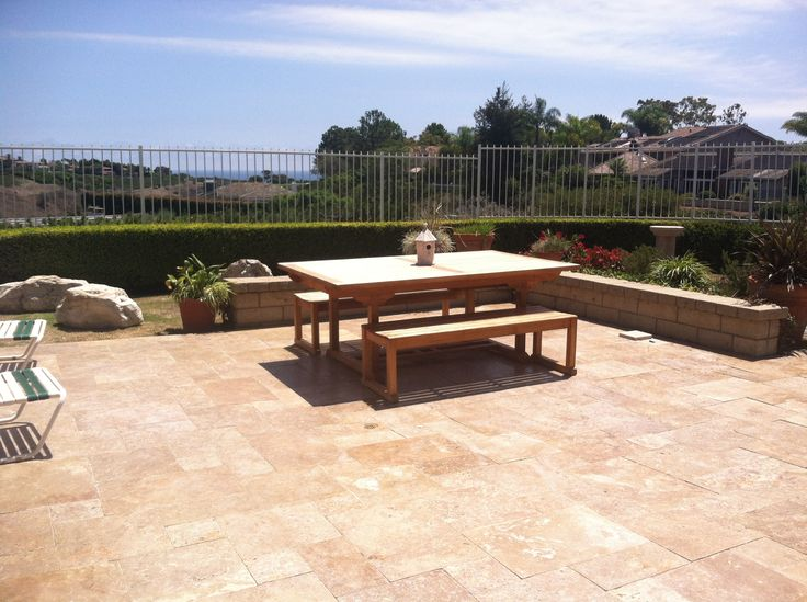 Pavescapes Travertine Overlay installed in the patio area. Travertine color used  in this photo is Noce. #naturalstone #pavers #remodel #construction