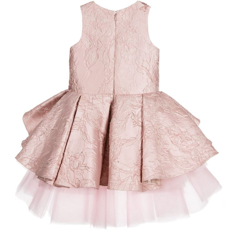 Ornate, pink silk jacquard dress by Mischka Aoki, encrusted with pink jewels, sequins and beads, and with a silver thread running through. There is a concealed zip and hook and eye fastener at the back and a matching, pleated peplum at the waist with many layers of pink tulle underneath, creating a fabulously full skirt, which is shorter at the front than the back. This lovely lined dress is absolutely perfect for any special occasion.