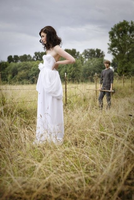Wedding dress and a grassy field.