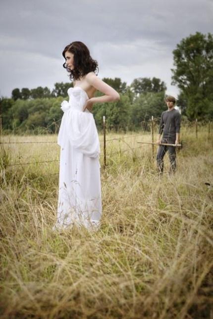 Wedding dress and a grassy field.