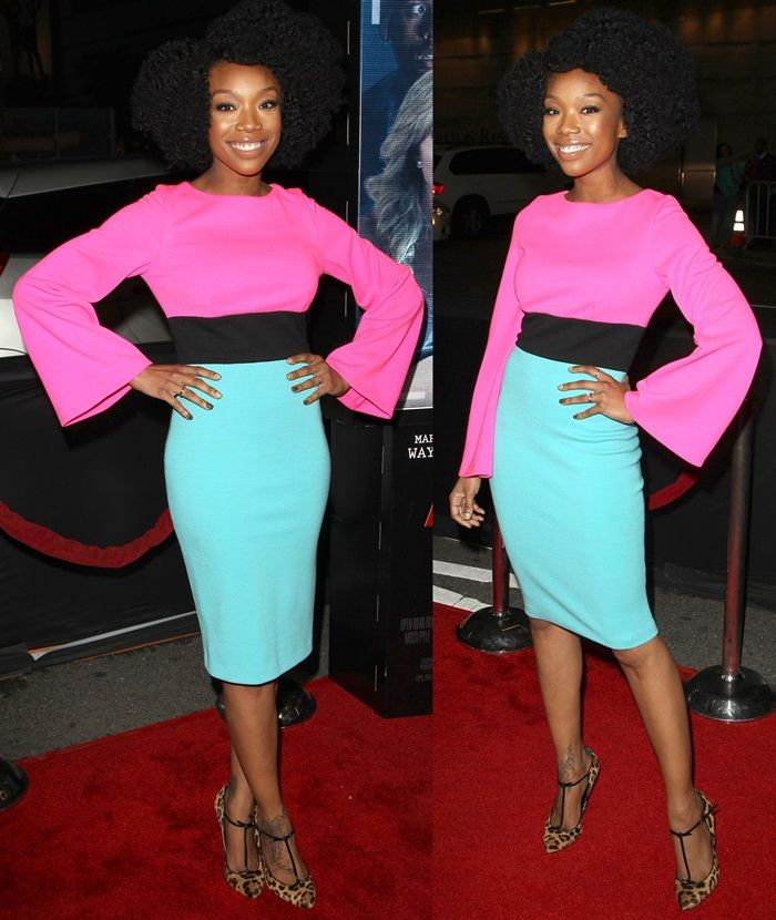 Brandy Norwood styled her dress featuring a pink top, a black waistband, and a knee-length turquoise skirt with a sexy pair of Gucci leopard-print T-bar pumps