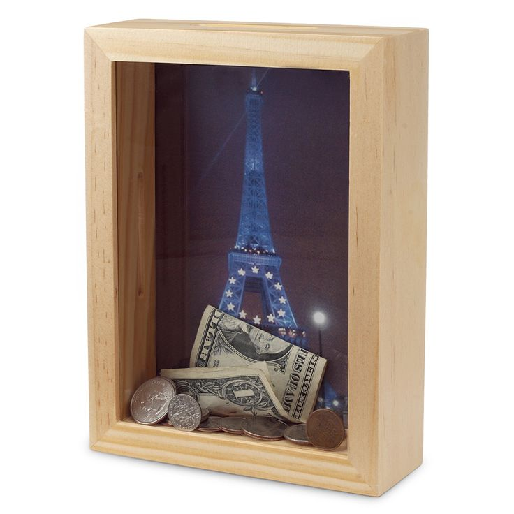 """I Have A """"Dream Bank"""". Buy a shadow box, put a picture of your dream vacation destination in it, cut a slot at the top, and start saving for your trip."""