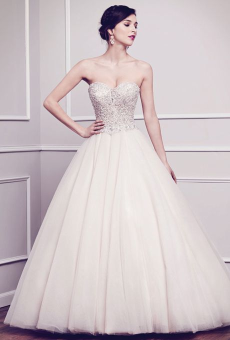 Brides: Kenneth Winston. Sweetheart bodice completely adorned with intricate bead work and patterns carefully hand sewn with over 30,000 beads is finished with a full volume ball gown. Zipper back.��See More Kenneth Winston Gowns