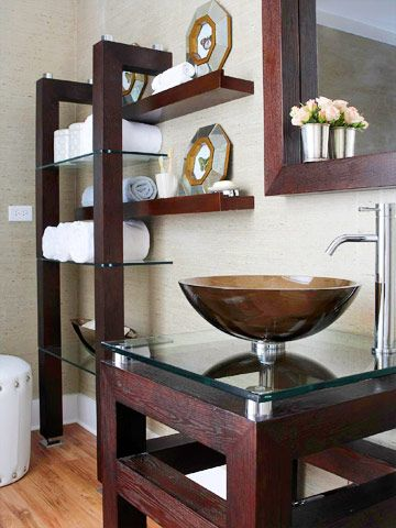 Upscale on a budget--- Fixtures: bathtub refinishing $175; vessel sink $150; sink faucet $150; sink cabinet base $300 Hardware and lighting: recessed ceiling lights $120; mirror $125 Walls: wallcovering: $270; tile $85; shelving unit $200; floating shelves $75 Total: $1,650