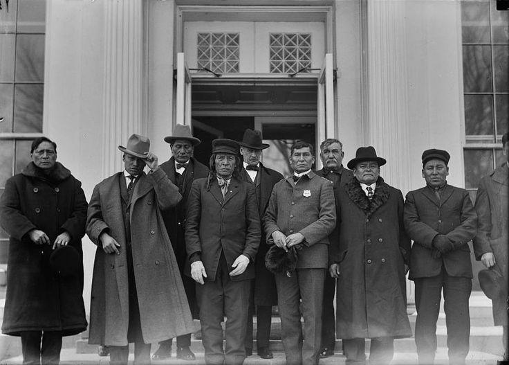 Leaders from Rosebud Reservation in South Dakota in Washington, D.C. - 1914 *Back row L-R: Hollow Horn Bear Jr. (Sicangu), Sen. Thomas Sterling (Senator for South Dakota), unidentified (non-Native) *Front row L-R: High Pipe (Sicangu), Charles Tackett (Sicangu), William Thunder Hawk (Sicangu), Eugene Little (Sicangu), Rueben Quick Bear (Sicangu), Henry Horse Looking (Sicangu), Silas Standing Elk (Sicangu)