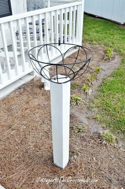 how to mount flower baskets onto wooden posts, curb appeal, diy, flowers, gardening, how to, repurposing upcycling, woodworking projects, We used U shaped staples to secure the wire baskets onto the posts