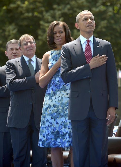 President Obama and First Lady Michelle Obama--remember when the rwnj's said he wasn't patriotic and didn't put his hand over his heart?