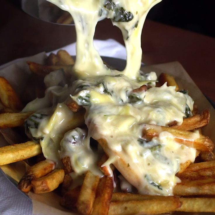 Get epic cheese pulls with these spinach and artichoke cheese fries.