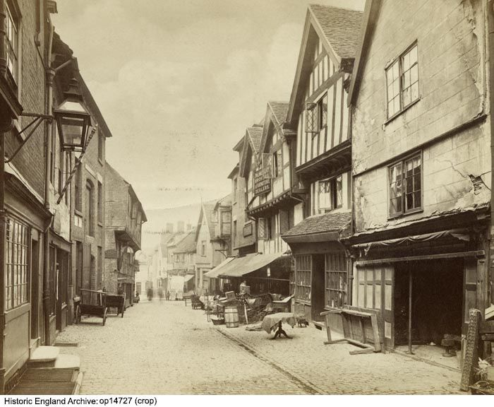 OP14727  A view looking north along Butcher Row, Coventry.  Furniture is displayed on the pavement in front of the premises of Palmer & Co, 'Brokers and Furniture Dealers'. Butcher Row was demolished in 1936 in order to make way for a new street layout to accommodate the motor car.  3 images of Kenilworth were stuck to the back of this print.  Format 1 Photograph (albumen print) (+1)  Date circa 1880  Photographer: Francis Bedford