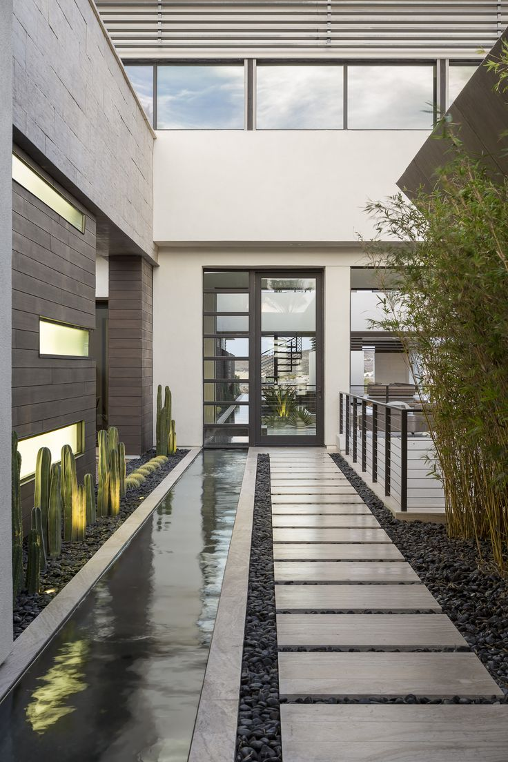 Blending indoor and outdoor spaces and incorporating water in the entry way of New American Home