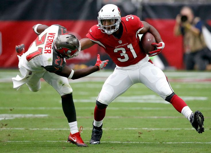 Arizona Cardinals running back David Johnson (31) stiff arms Tampa Bay Buccaneers cornerback Alterraun Verner (21) during the first half of an NFL football game, Sunday, Sept. 18, 2016, in Glendale, Ariz.